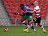 Paul Keegan (R) of Doncaster Rovers challenges Jay Emmanuel-Thomas of Bristol City during the FA Cup Third Round match on January 3, 2015