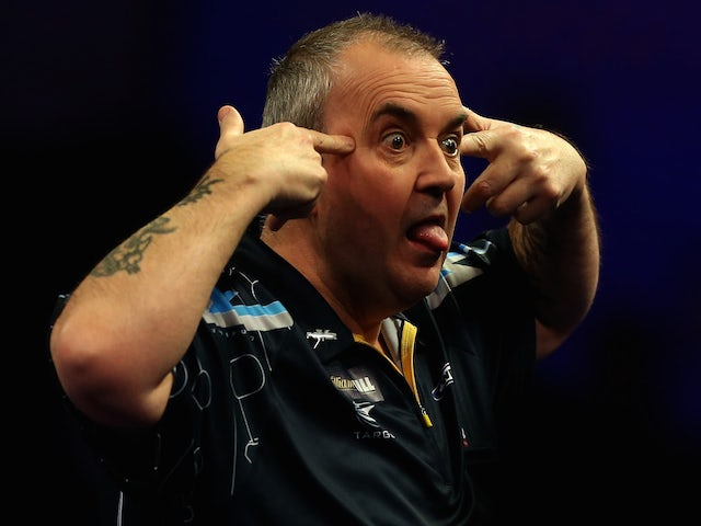 Phil Taylor of England reacts after winning a set during his quarter final match against Vincent van der Voort of the Netherlands on day twelve of the 2015 World Championships on January 2, 2015