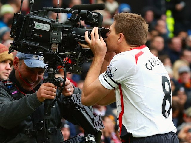 Steven Gerrard of Liverpool celebrates scoring the second goal by kissing the steadicam during the Barclays Premier League match against Manchester United at Old Trafford on March 16, 2014