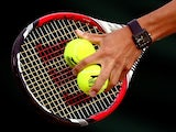 Detail shot of Kei Nishikori of Japan's racquet and slazenger tennis balls during his Gentlemen's Singles third round match against Simone Bolelli of Italy on day six of the Wimbledon Lawn Tennis Championships at the All England Lawn Tennis and Croquet Cl