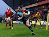 Tom Williams of Harlequins crosses the line to score the final try during the Aviva Premiership match between London Welsh and Harlequins at the Kassam Stadium on January 4, 2015