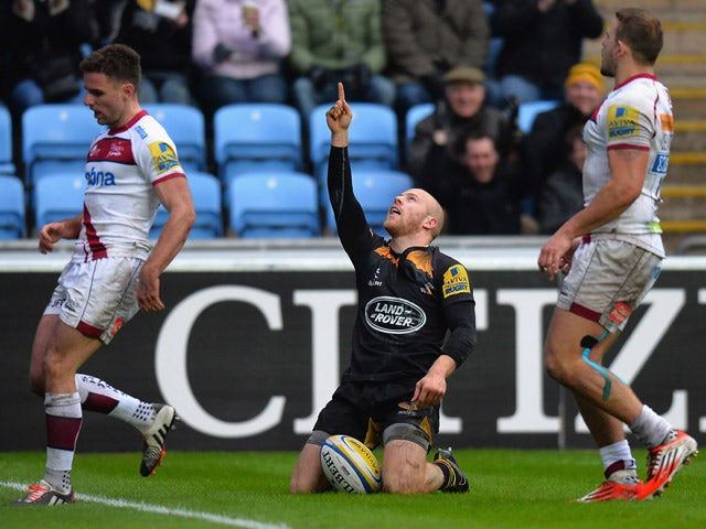 Joe Simpson of Wasps celebrates after scoring their third try during the Aviva Premiership match between Wasps and Sale Sharks at The Ricoh Arena on January 4, 2015