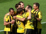 Manny Muscat of the Phoenix is congratulted on his goal by teammates during the round 15 A-League match between the Wellington Phoenix and Brisbane Roar at Westpac Stadium on January 4, 2015