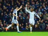 Saido Berahino of West Bromwich Albion celebrates with Graham Dorrans as he scores their first goal during the Barclays Premier League match between West Ham United and West Bromwich Albion at Boleyn Ground on January 1, 2015