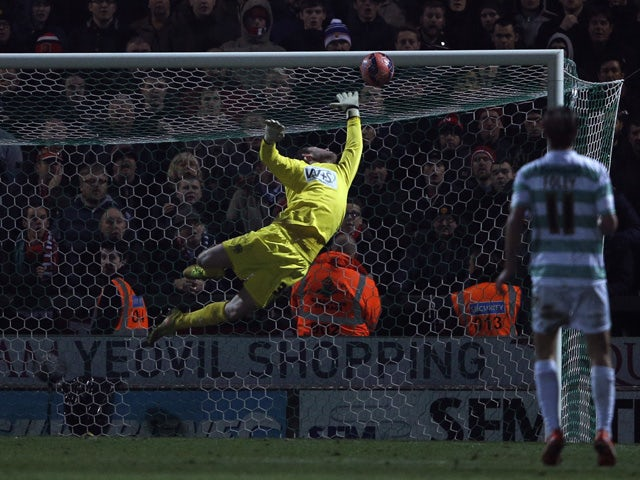 The ball goes beyond Yeovil Town's English goalkeeper Jed Steer as he dives but fails to save the shot from Manchester United's Spanish midfielder Ander Herrera for the opening goal during the English FA Cup third round football match between Yeovil Town