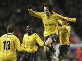 Tomas Rosicky of Arsenal celebrates scoring the opening goal during the FA Cup sponsored by E.ON Third Round match between Liverpool and Arsenal at Anfield on January 6, 2007