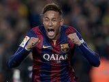 Barcelona's Brazilian forward Neymar da Silva Santos Junior celebrates his goal during the Spanish league football match FC Barcelona vs Club Atletico de Madrid at the Camp Nou stadium in Barcelona on January 11, 2015