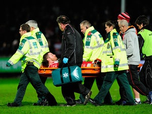 Ben Morgan of Gloucester is stretchered off with an injury during the Aviva Premiership match between Gloucester Rugby and Saracens at Kingsholm Stadium on January 9, 2015