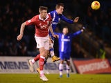 Brennan Dickenson of Gillingham battles with Aden Flint of Bristol City during the Johnstone's Paint Southern Area Final first leg, on January 6, 2015