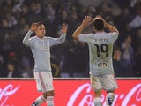 Celta's Chilean forward Fabian Orellana celebrates with teammate defender Jonny Castro after scoring a goal during the Spanish league football match RC Celta de Vigo vs Valencia CF at the Balaidos stadium in Vigo on January 10, 2015