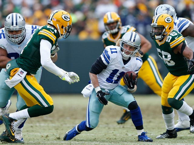Cole Beasley #11 of the Dallas Cowboys carries the football against Sam Barrington #58 of the Green Bay Packers during the 2015 NFC Divisional Playoff game at Lambeau Field on January 11, 2015