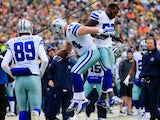 Tyler Clutts #44 of the Dallas Cowboys celebrates after scoring a touchdown against the Green Bay Packers in the first quarter during the 2015 NFC Divisional Playoff game at Lambeau Field on January 11, 2015