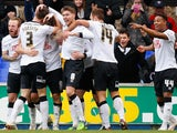 Derby County players celebrate after Chris Martin scored during the Sky Bet Championship match between Ipswich Town and Derby County at Portman Road on January 10, 2015