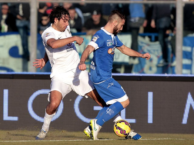 Lorenzo Tonelli of Empoli FC battles for the ball with Luca Toni of Hellas Verona FC during the Serie A match between Empoli FC and Hellas Verona FC at Stadio Carlo Castellani on January 6, 201