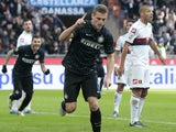 Inter Milan's Nemanja Vidic celebrates after scoring during the Italian Serie A football match Inter Milan vs Genoa on January 11, 2015