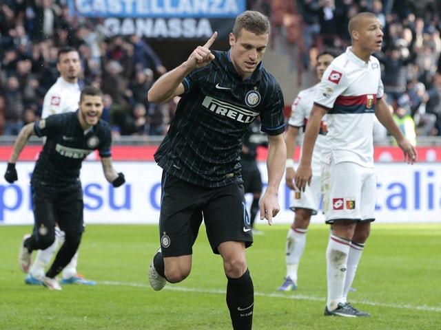 Inter Milan's Nemanja Vidic celebrates after scoring during the Italian Serie A football match Inter Milan vs Genoa on January 11, 2015