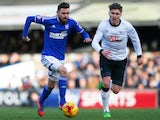 Paul Anderson of Ipswich Town is chased by Jeff Hendrick of Derby County during the Sky Bet Championship match between Ipswich Town and Derby County at Portman Road on January 10, 2015