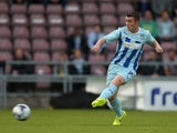 John Fleck of Coventry City in action during the Capital One Cup First Round match between Coventry City and Cardiff City at Sixfields Stadium on August 13, 2014