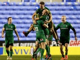 London Irish players celebrate with Shane Geraghty after he kicks the winning points with a drop goal during the Aviva Premiership match between London Irish and Exeter Chiefs at Madejski Stadium on January 11, 2015