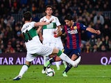 Luis Suarez of FC Barcelona scores his team's second goal during the Copa del Rey Round of 16 First Leg match against Elche CF on January 8, 2015