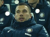 Lukas Podolski of FC Internazionale Milano sits on the bench during the Serie A match between Juventus FC and FC Internazionale Milano at Juventus Arena on January 6, 2015