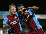Lyle Taylor (R) of Scunthorpe celebrates with teammate Callum Howe (L) after scoring his team's second goal during the FA Cup Third Round match against Chesterfield on January 6, 2015