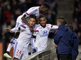 Lyon's French forward Alexandre Lacazette is congratulated by teammates after scoring a goal during the French L1 football match Lyon (OL) vs Toulouse (TFC) on January 11, 2015