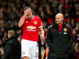 Robin van Persie of Manchester United reacts as he leaves the pitch during the Barclays Premier League match between Manchester United and Southampton at Old Trafford on January 11, 2015