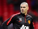 Manchester United's Spanish goalkeeper Victor Valdes warms up ahead of the English Premier League football match between Manchester United and Southampton at Old Trafford in Manchester, north west England, on January 11, 2015