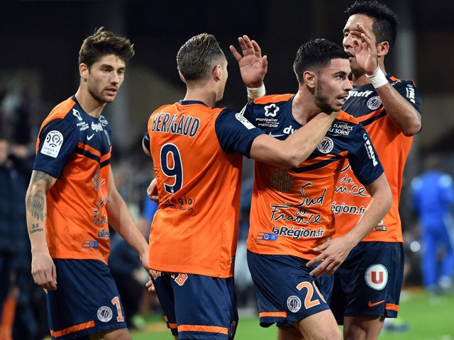 Montpellier's players celebrate after scoring a goal during the French L1 football match between Montpellier and Marseille at the La Mosson Stadium in Montpellier, southern France, on January 9, 2015