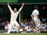 Nathan Lyon of Australia celebrates after taking the wicket of Wriddhiman Saha of India during day five of the Fourth Test match between Australia and India at Sydney Cricket Ground on January 10, 2015