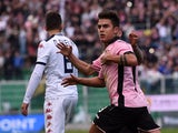 Paulo Dybala of Palermo celebrates after scoring his team's third goal during the Serie A match between US Citta di Palermo and Cagliari Calcio at Stadio Renzo Barbera on January 6, 2015