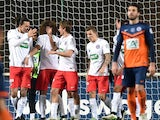 Paris Saint-Germain's players celebrate after scoring a goal during the French Cup football match Montpellier vs PSG, on January 5, 2015