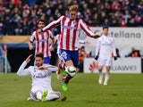 Real Madrid's defender Sergio Ramos vies with Atletico Madrid's forward Fernando Torres during the Spanish Copa del Rey round of 16 first leg football match Club Atletico de Madrid vs Real Madrid CF at the Vicente Calderon stadium in Madrid on January 7,