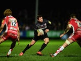 Saracens player Alex Goode makes a break during the Aviva Premiership match between Gloucester Rugby and Saracens at Kingsholm Stadium on January 9, 2015