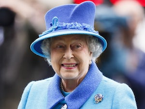 The Queen smiles as she watches horses on October 18, 2014