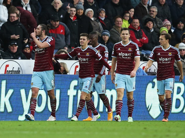 Andy Carroll of West Ham United celebrates scoring the opening goal with team mates during the Barclays Premier League match between Swansea City and West Ham United at Liberty Stadium on January 10, 2015