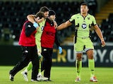 Ben Foden of Northampton Saints is taken off injured during the match with Ospreys on January 18, 2015