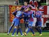 Caen's French midfielder Julien Feret is congratulated by his teamates after scoring a goal during the French L1 football match between Caen (SM Caen) and Reims (RS), on January 17, 2015