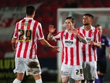 Jack Dunn of Cheltenham Town (C) celebrates scoring his side's first goal during the Sky Bet League Two match between Cheltenham Town and Morecambe at Whaddon Road on January 16, 2015