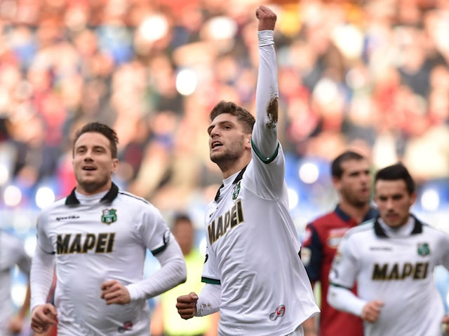 Domenico Berardi (C) of US Sassuolo Calcio celebrates the opening goal during the Serie A match against Genoa on January 18, 2015