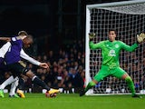Enner Valencia of West Ham United shoots past goalkeeper Joel Robles of Everton to score their first goal during the FA Cup Third Round Replay on January 13, 2015