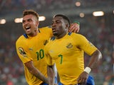 Gabon's Malick Evouna celebrates with teammate Fredeic Wagha after scoring a goal during the 2015 African Cup of Nations group A football match between Burkina Faso and Gabon at Bata Stadium in Bata on January 17, 2015