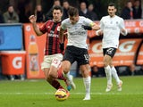 Gustavo Denis of Atalanta BC competes for the ball with (L) Daniele Bonera of AC Milan during the Serie A match on January 18, 2015