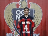 Nice's new midfielder Hatem Ben Arfa poses with his new jersey during his official presentation, on January 5, 2015