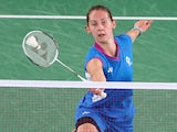 Kirsty Gilmour of Scotland plays a forehand as she competes in her women's singles badminton quarter-final match at Emirates Arena on August 1, 2014