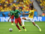 Landry N'Guemo of Cameroon controls the ball against Paulinho of Brazil during the 2014 FIFA World Cup Brazil Group A match between Cameroon and Brazil at Estadio Nacional on June 23, 2014