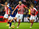 Anthony Knockaert of Leicester City battles for the ball with Marc Wilson of Stoke City during the Barclays Premier League match between Leicester City and Stoke City at The King Power Stadium on January 17, 2015