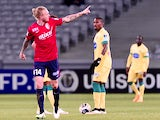 Lille's Danish defender Simon Kjaer (L) celebrates after scoring his team's second goal during the French League Cup football match Lille (LOSC) vs Nantes (FCN) on January 14, 2014