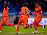 Lionel Messi is congratulated by Neymar after scoring Barcelona's opener against Deportivo La Coruna on January 18, 2015